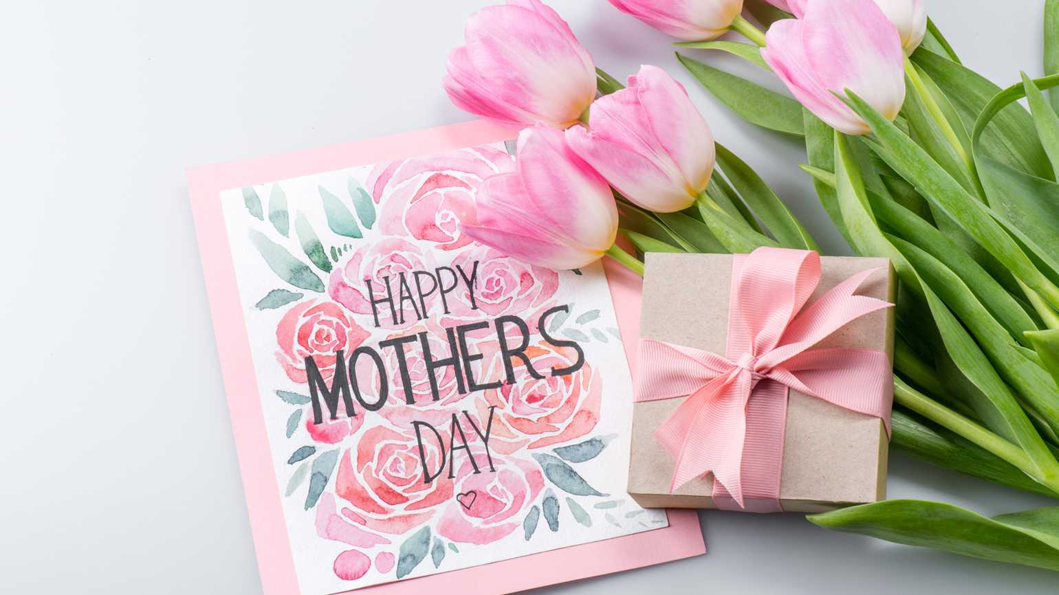 Beautiful pink tulips and a happy mother's day postcard and gift