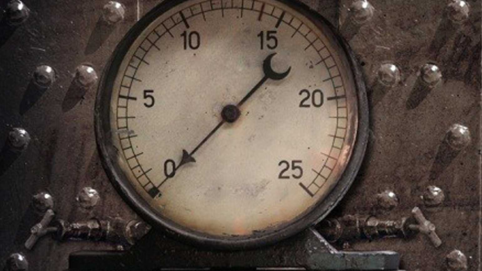 A pressure gauge on an old furnace