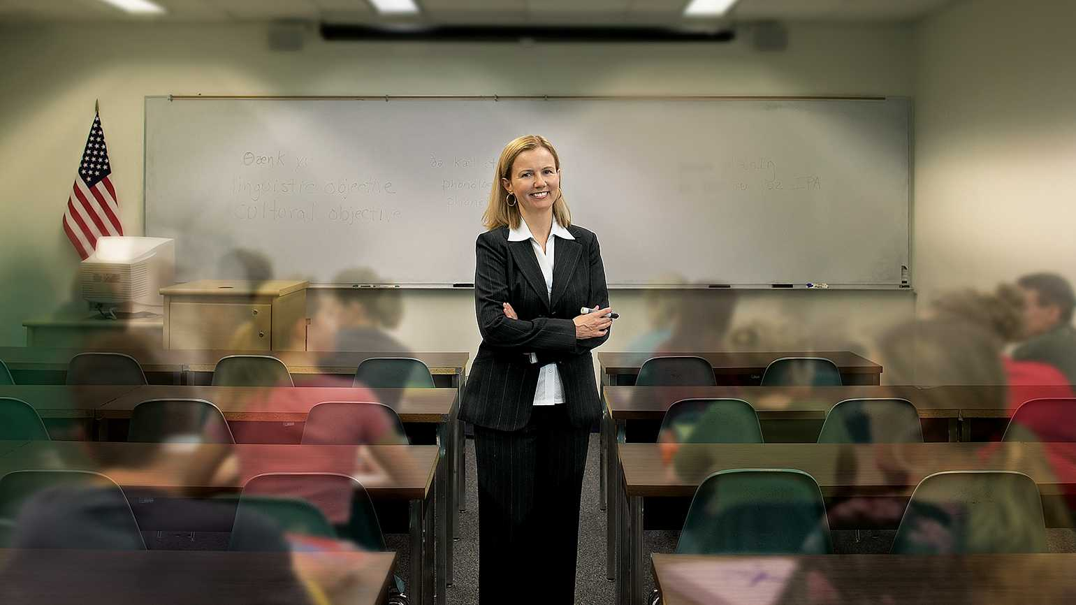 Joyce stands surrounded by her students in a classroom