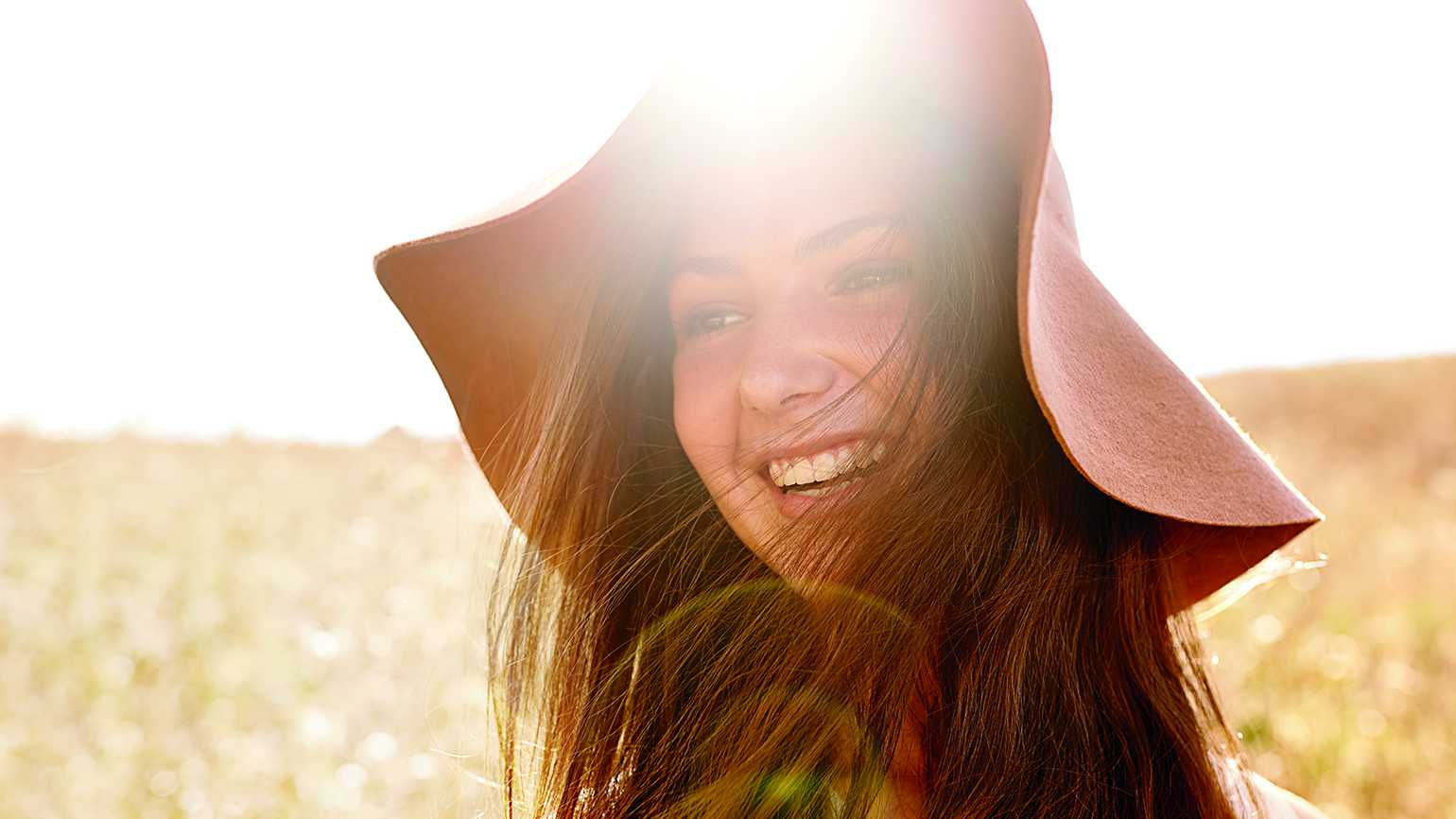 Young, smiling woman outdoors