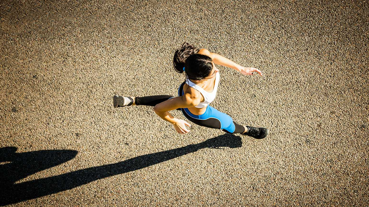 Overhead shot of woman running marathon