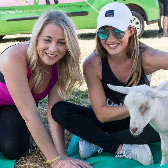 Goat Yoga: Participants enjoy petting the goats before, during and after class. Better Living Health Wellness