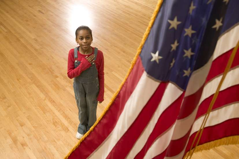 Young Girl pledges allegiance to the American Flag