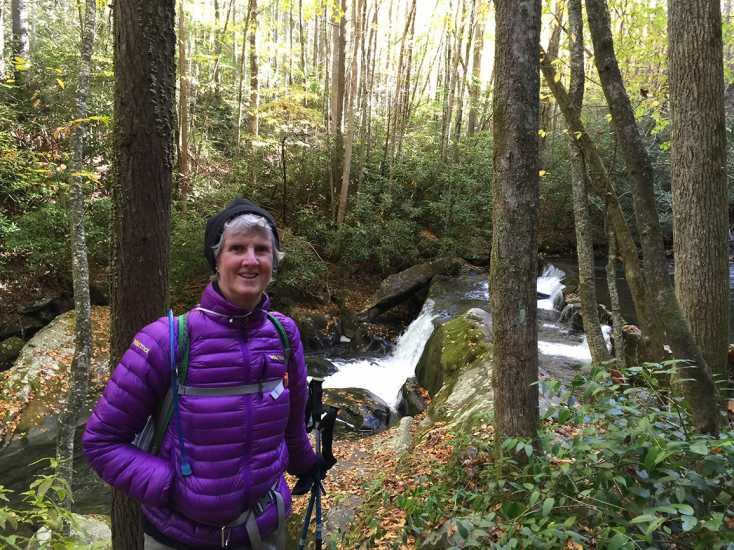 Jo-Anne pauses by a small waterfall in a stream in the Great Smoky Mountains National Park, America's most visited national park.