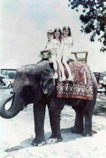 Marcia Jines and her siblings atop an elephant