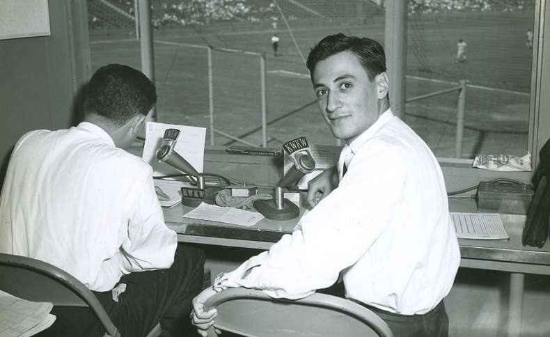 Jaime Jarrin is seen in the Dodgers press box in this photograph from the 1950s.