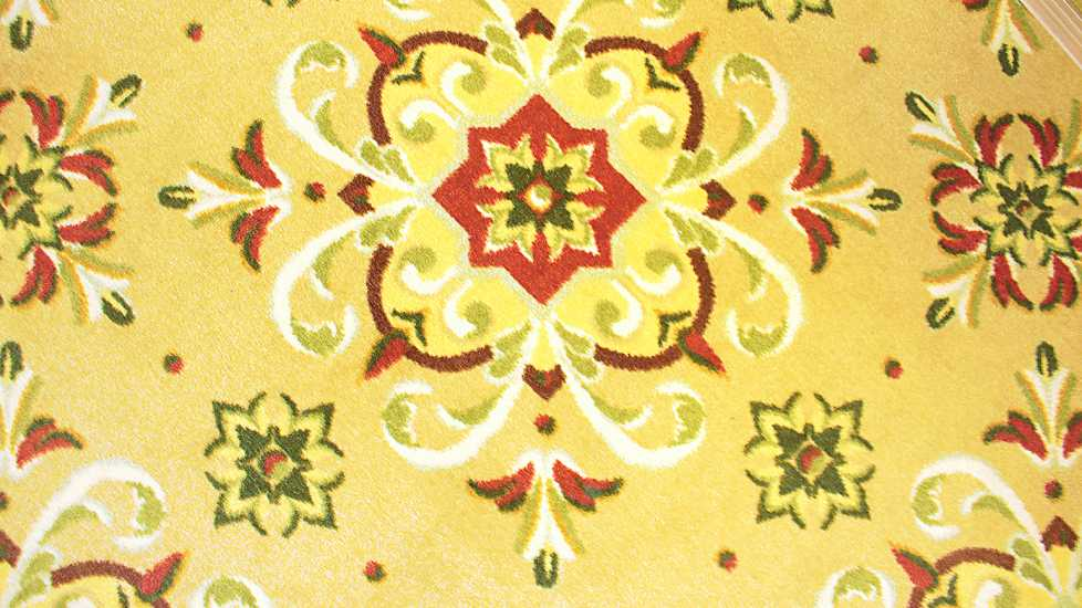 An angel is woven into the pattern of the Dogwood Village carpet