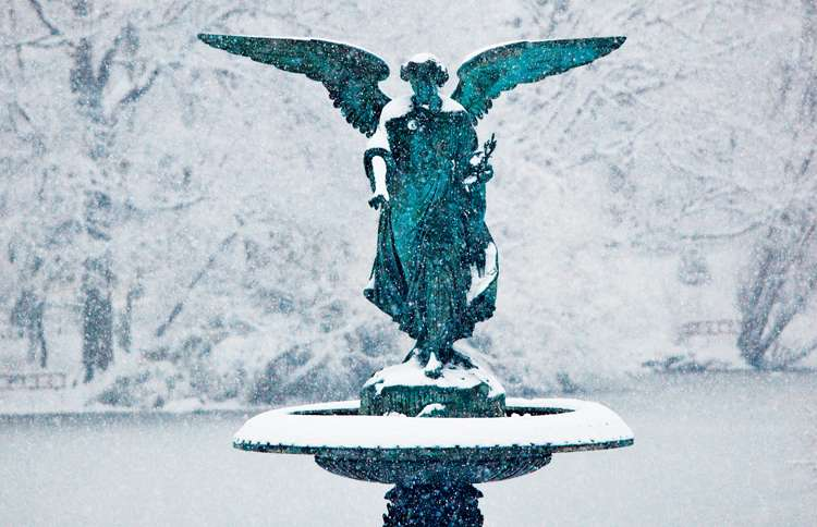 The angel on NYC's Bethesda fountain on a snowy day
