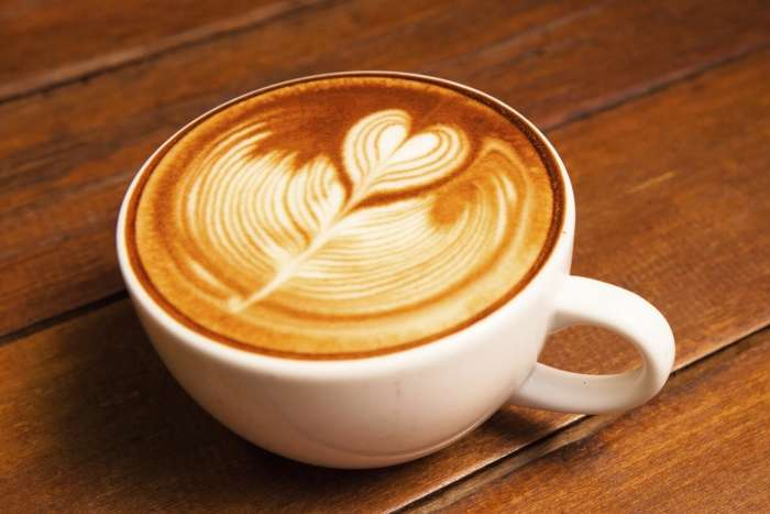 Person treating a coffee for Be an Angel Day