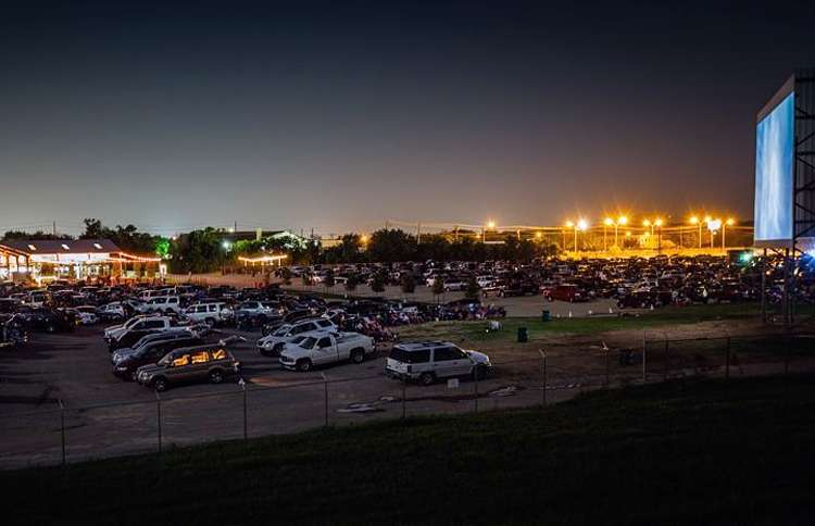 The Coyote Drive-in lights up the night sky in downtown Fort Worth.
