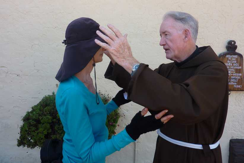 Day 21: Edie receives a blessing from Father Gerald Barron at Mission Santa Ines.