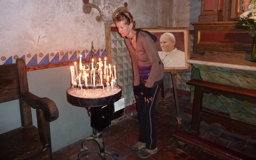 Day 40: Edie lights a candle at Mission Carmel.