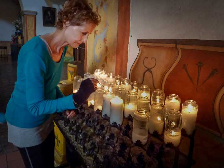 Day 45: Edie lights a candle at Mission San Juan Bautista after traveling nearly 14 miles from Salinas.