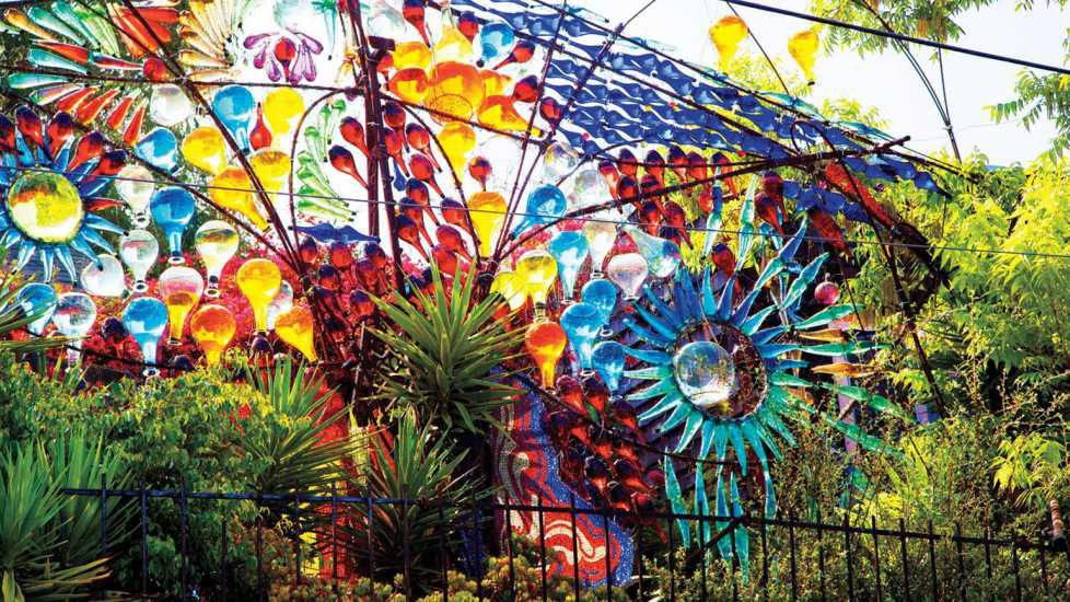 Drive-By Design of Randlett Lawrence, who has fashioned a huge sculpture made out of bottles and other glass which fronts his humble home in Echo Park district of Los Angeles.