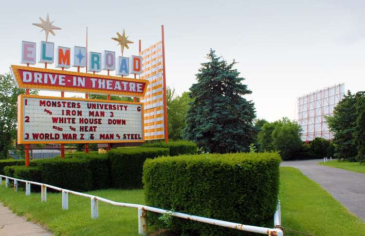 The Elm Road Drive-in beckons from the side of the road.