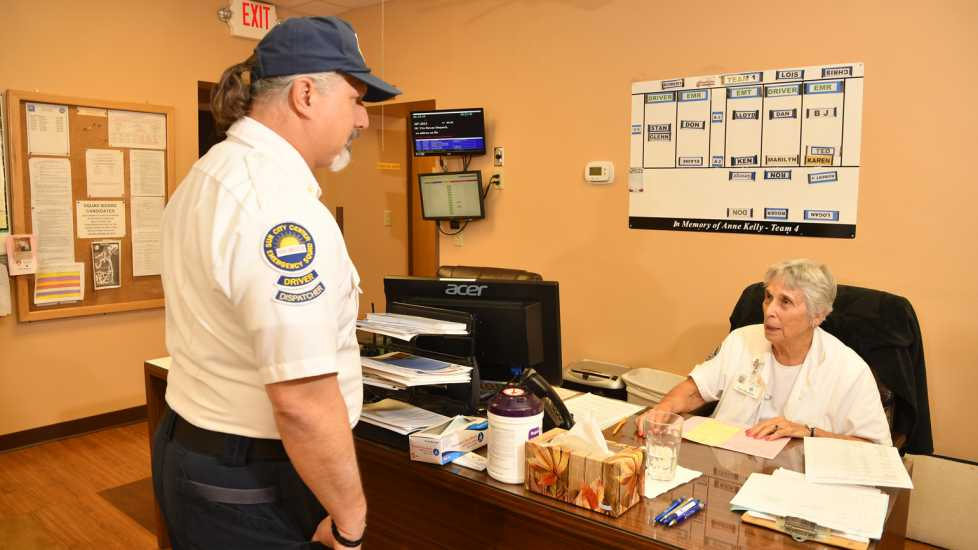 Captain Robert Leonard talking to Coordinator Louis Shannon. She keeps track of the ambulances.