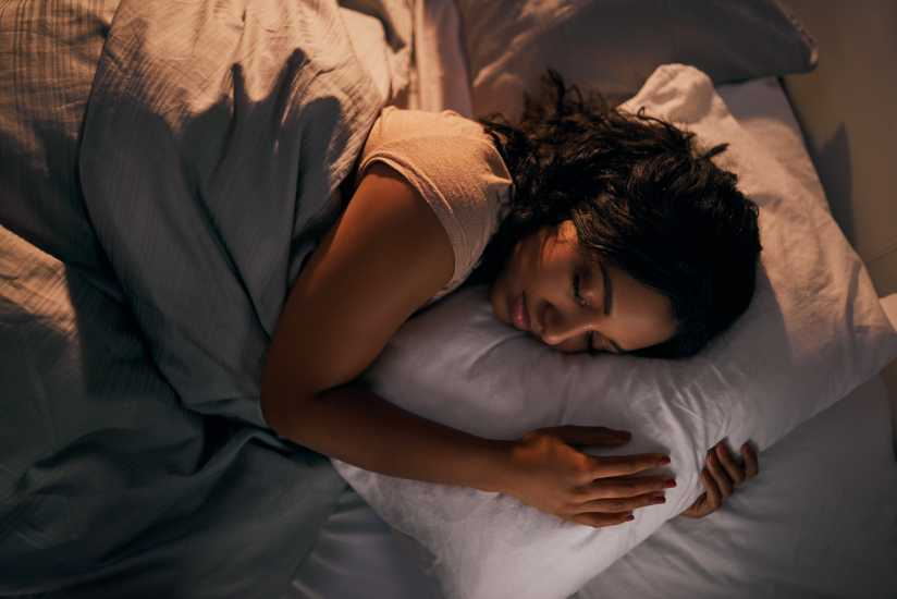 A woman sleeping in bed.
