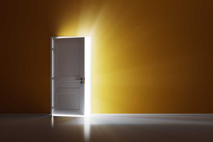 A door open with light streaming through; Getty Images