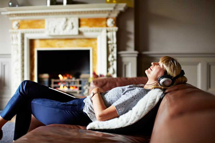 Woman relaxing, listening to music