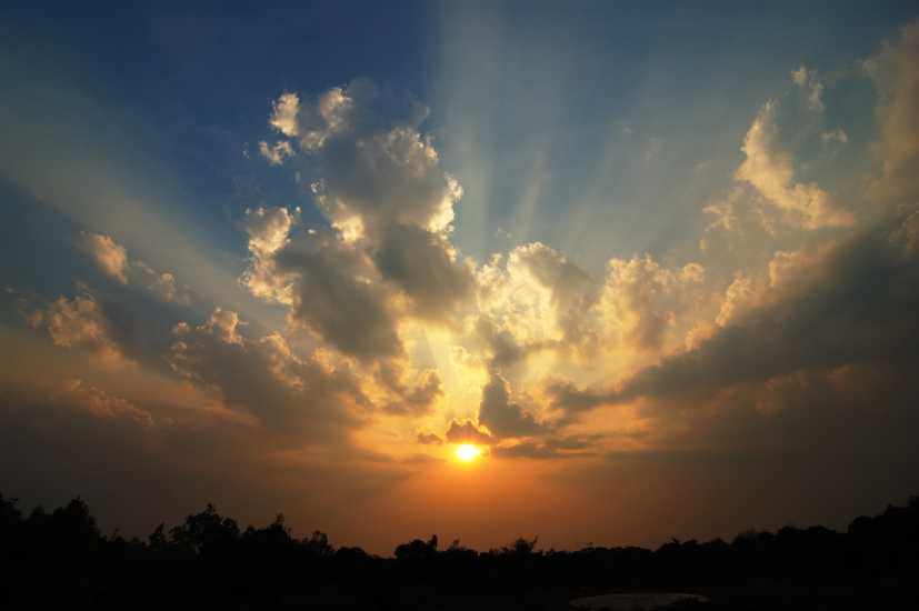 The sun breaking through clouds; Getty Images