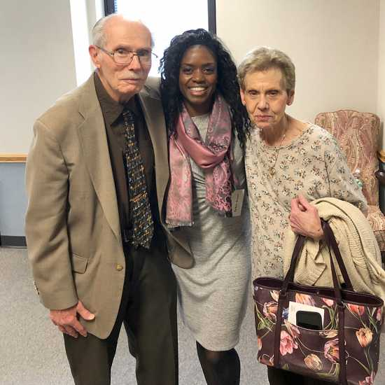 Guideposts staffer Ty'Ann Brown (center) greets a pair of attendees for Good Friday Day of Prayer.