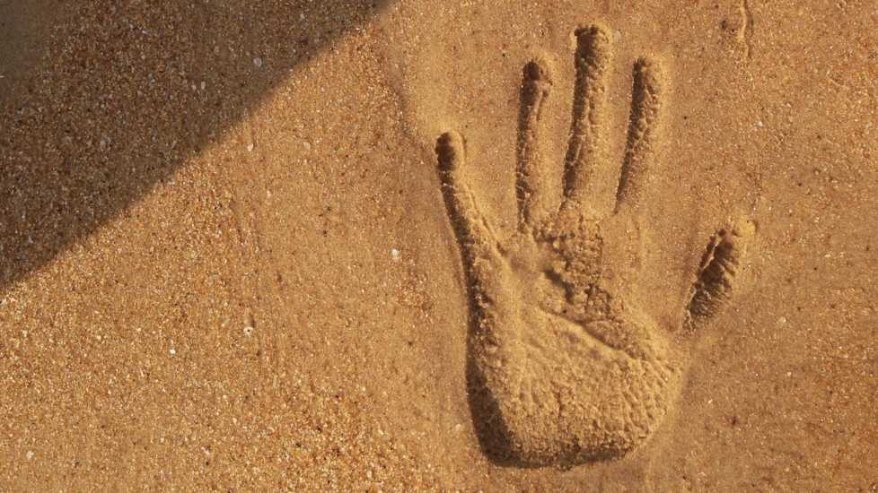 Handprint in the sand; Getty Images