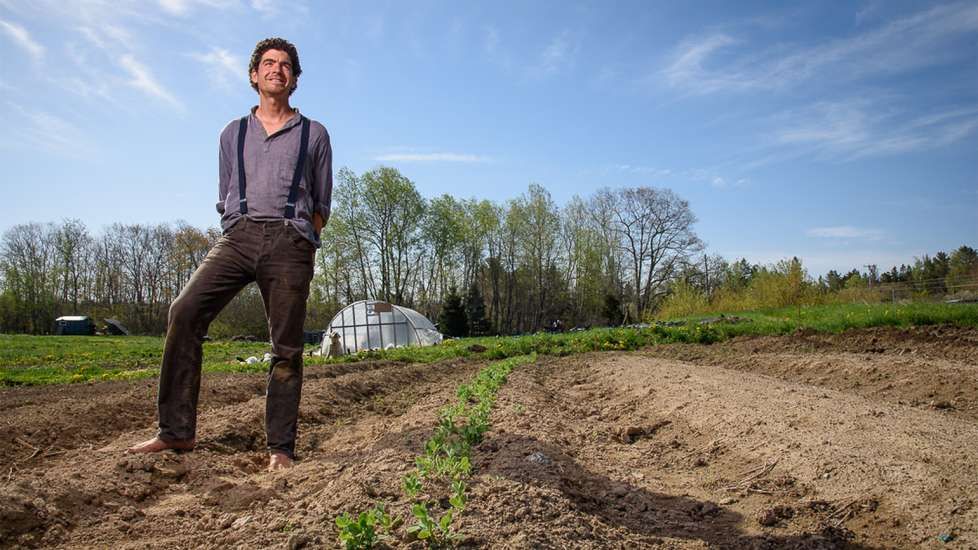 Michael Hayden stands in a field on his Maine farm