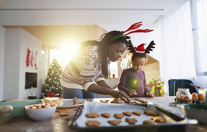 Mother and daughter bakng holiday cookies