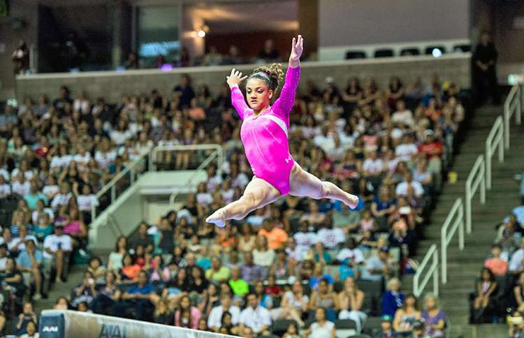 Laurie Hernandez competes for the US Women's gymnastics team