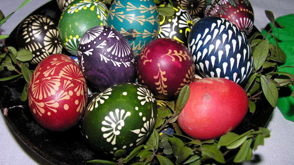 Colorfully dyed Easter eggs on a plate with various designs from Lithuania
