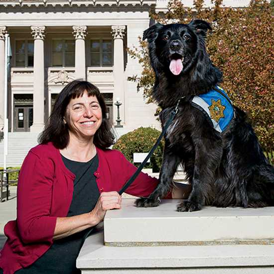 Lori Raineri and her dog, Daisy; photo by Fred Greaves