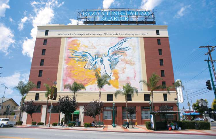 A Los Angeles mural depicting a pair of angels flying together