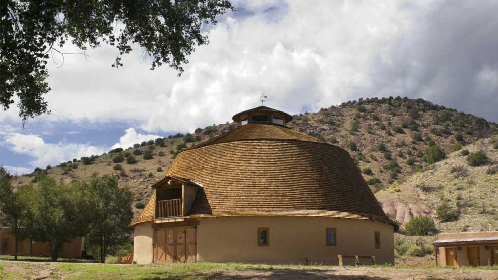 The round barn at Ojo Caliente Mineral Springs was built in 1924. It is the only round barn in New Mexico and possibly the only remaining adobe round barn in the United States. It was added to the National Register of Historic Places in 1985.