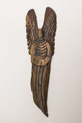 Guideposts: One of  Paula Dimit's carved wooden angels