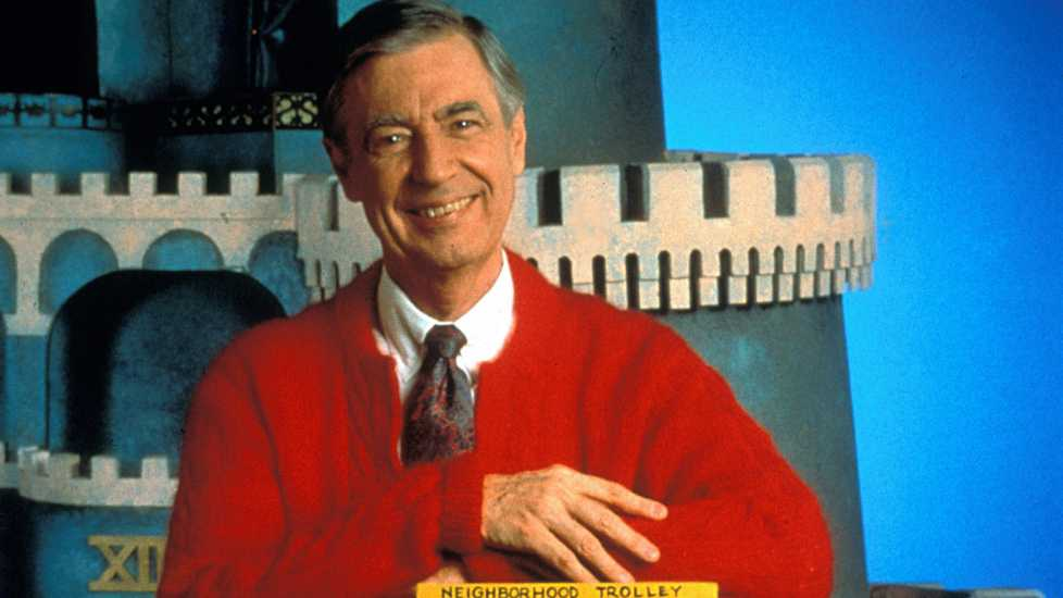 Fred Rogers in front of the castle used in his children's television series.