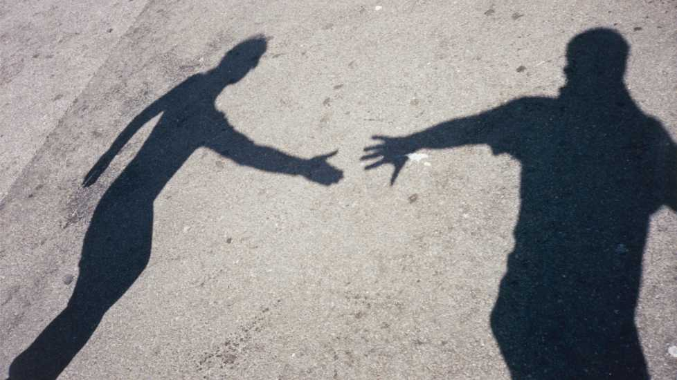 Two shadows reaching for each other; Getty Images