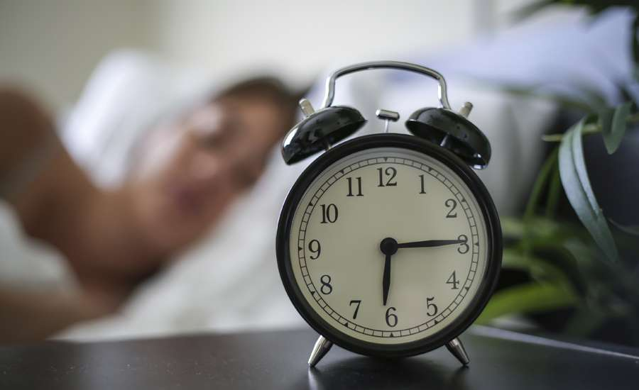 Alarm clock, woman sleeping