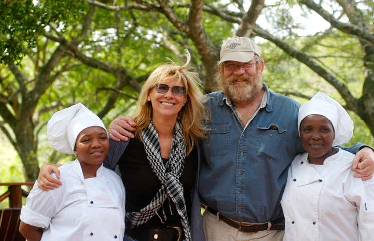 Guideposts: Françoise and Lawrence pose with two of the workers on the game reserve