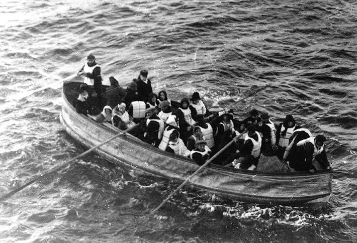 Guideposts: A lifeboat in the water, filled with refugees from the Titanic