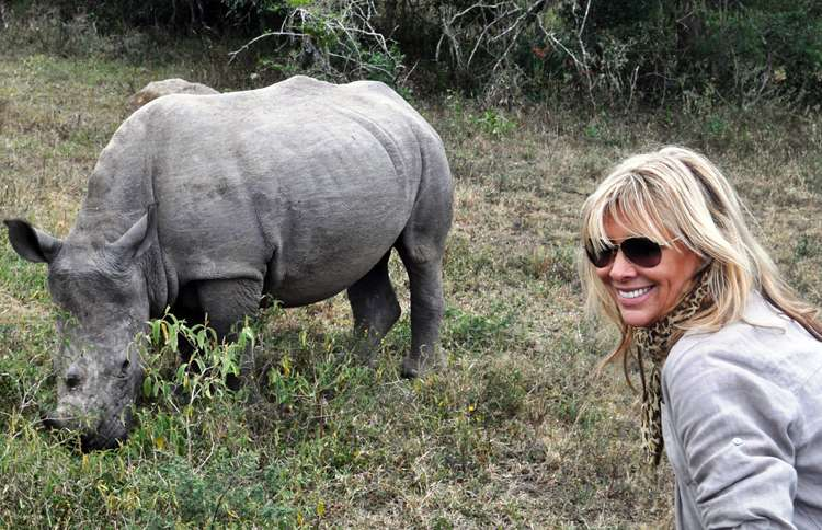 Guideposts: Françoise poses with a rhinocerous
