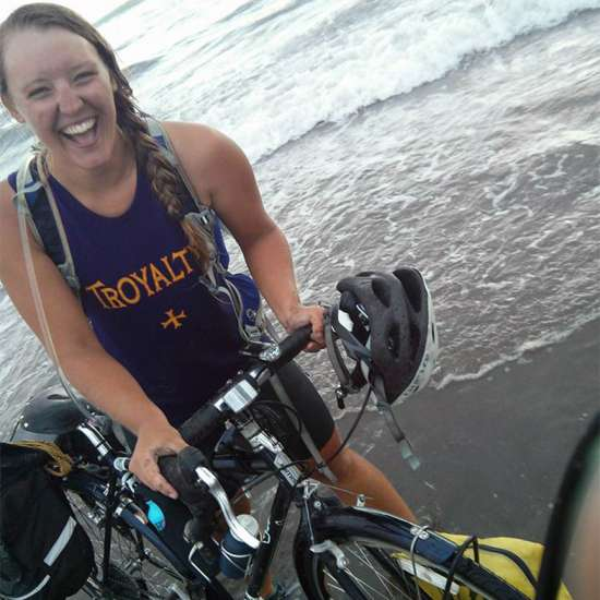 Deborah celebrates the end of her journey by enjoying a splash in the Pacific Ocean on the Oregon Coast.