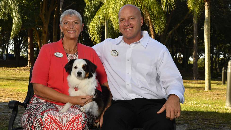 Jack relaxes with Laura Diachenko, his human, and Pastor Tom Hafer at the Gulf Coast Village in Cape Coral, Florida.