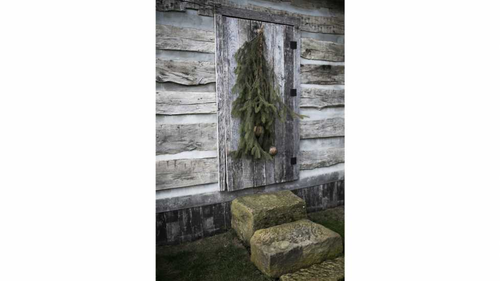 Ginny Curry's old fashioned log cabin decorated for Christmas in Lancaster, OH on January 8, 2018. Curry's husband Bill began to build the cabin and then fell ill and passed away. With the help of friends, they completed the authentic log cabin.
