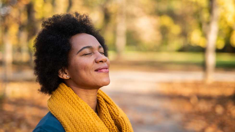 A woman enjoying the Autumn weather; Getty Images