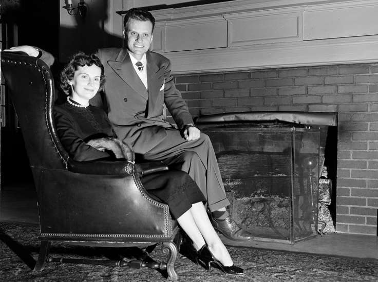 Graham and his wife, Ruth, sit by the fireplace at the Carolina Inn in Chapel Hill, North Carolina, in a photograph taken on February 8, 1951.