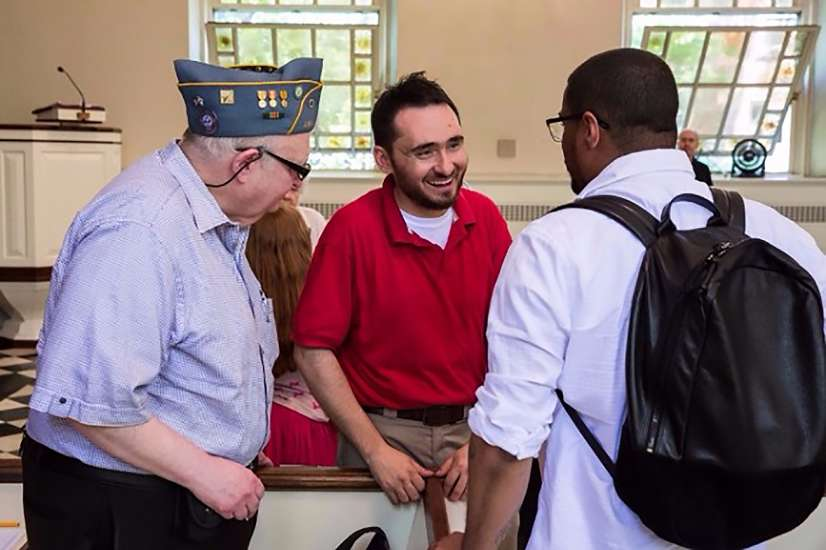 Steven greets a pair of military veterans in attendance at one of his band's performances