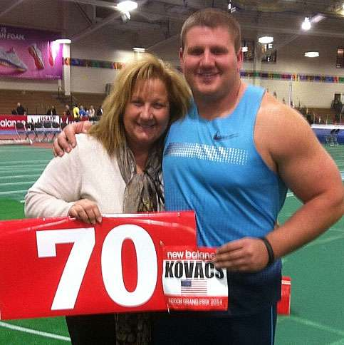 Joe and Joanna celebrate his first shot-put throw over the 70-foot mark in Boston in 2014.