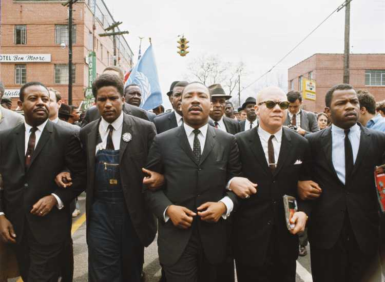 Martin Luther King leading a march from Selma to Montgomery.