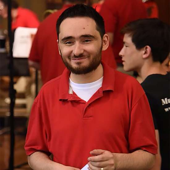 Steven poses following a performance of the Patriotic Brass Ensemble