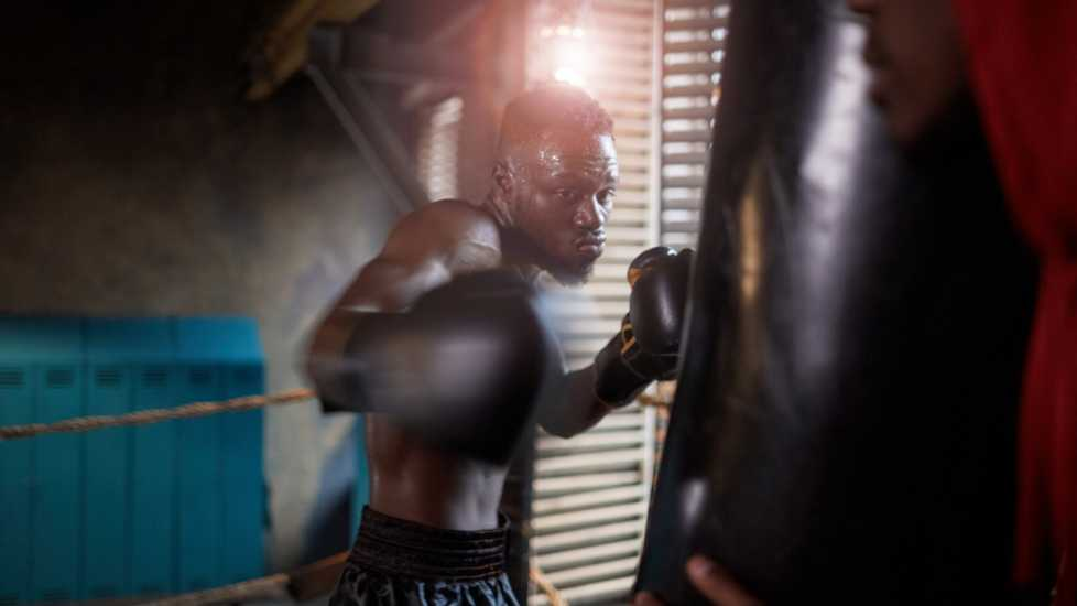 Man boxing in a gym; Getty Images